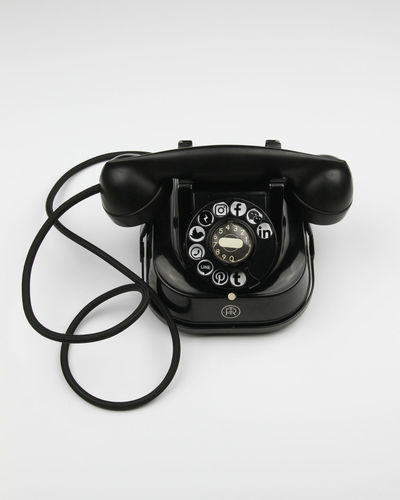 Close-up of telephone booth against white background