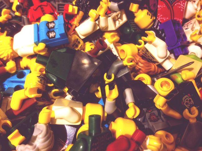 A pile of Lego men. High Angle View Multi Colored LEGO Toy Toys Men Figures Plastic Pile Jumble Jumbled Mixed Up Indoors  Technology Close-up Day