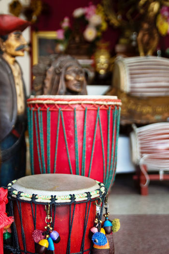 Close-up of drums for sale at store
