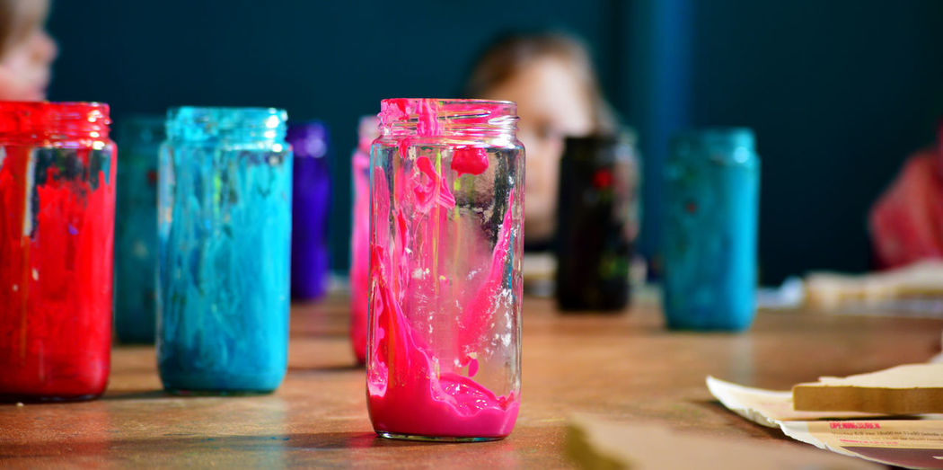 Paints In Jars On Table