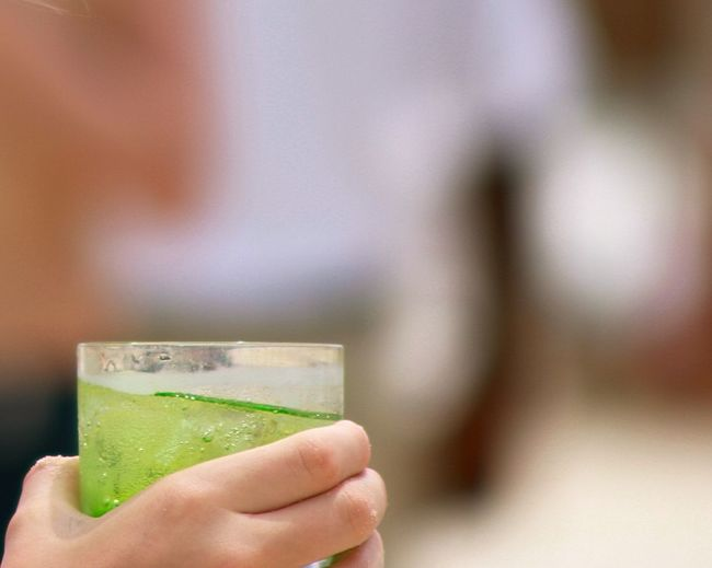 Cropped hand holding lemonade