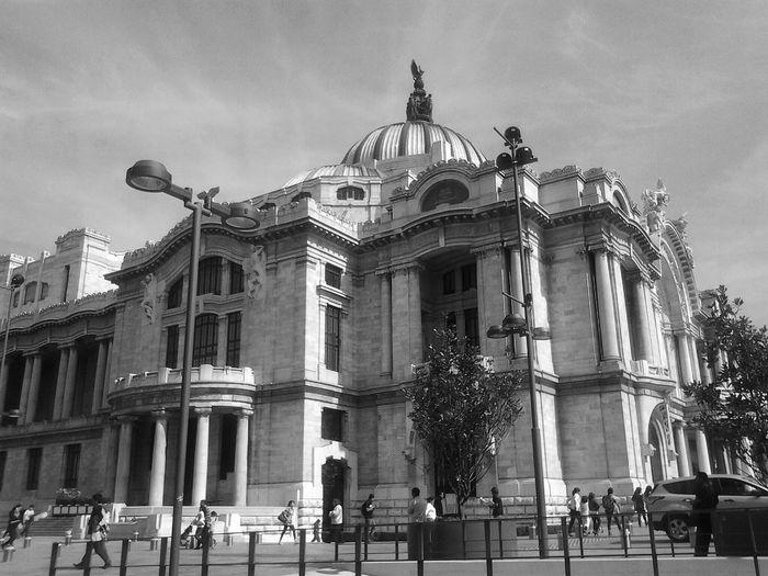 Tourist at palacio de bellas artes against sky