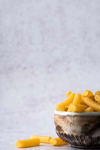 uncooked pasta in a bowl with copy space   food photography Food Food And Drink Freshness Yellow No People Still Life Focus On Foreground Close-up Pasta Uncooked Bowl Food Photography Raw Food Foodphotography negative space Copy Space Nikonphotographer