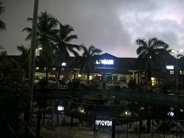 Amazing Restaurant Best Of EyeEm Built Structure Chill Climate City City Life Cloud Cloud - Sky Evening Light Evening Time During Rainy Season Goa India Illuminated Incredeble Information Information Sign Luxury No People Outdoors Rainy Days Reflection, Pattern In Water, Water, Ripples, Waves, Blue, Curvy Sky Snapshot Tree Water Reflections Wonderful