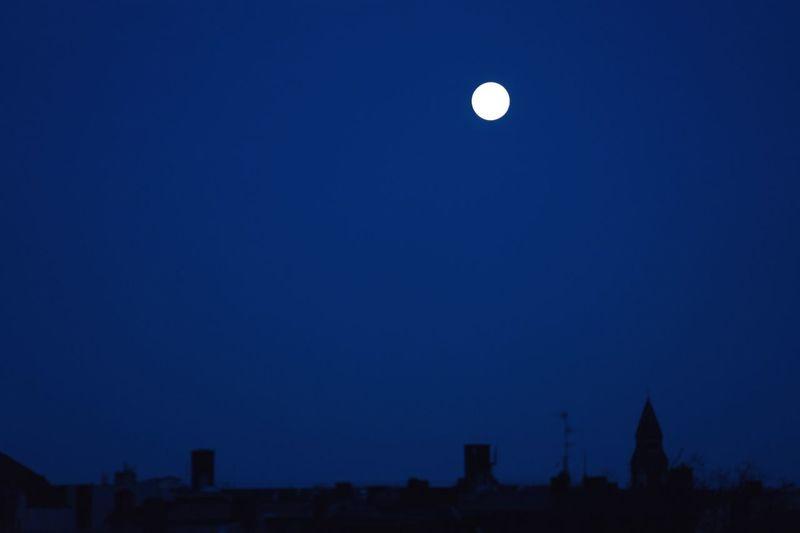 Full moon in blue sky at night