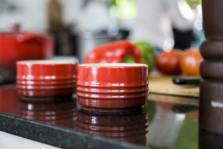 Close-Up Of Containers On Kitchen Table