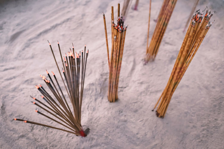 Incenses or joss sticks in chinese temple, old film look effect, shallow depth of field