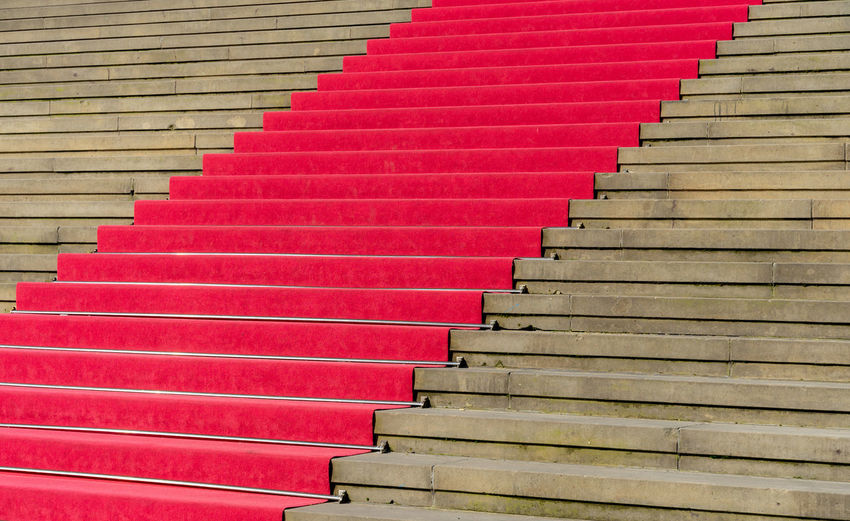 Carpet Minimalism Minimalistic Red Color Low Angle View Architecture Staircase Steps And Staircases Railing No People In A Row Indoors  Pattern Moving Up Built Structure The Way Forward Direction Red Repetition Diminishing Perspective Absence Multi Colored Building Day High Angle View Krull&Krull Minimalistic Red Carpet