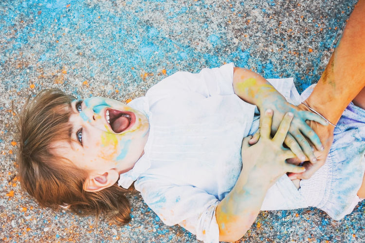 Child Real People Leisure Activity Childhood High Angle View Women Lifestyles Females Girls People Day Human Body Part Innocence Lying Down Two People Togetherness Enjoyment Outdoors Positive Emotion Swimming Pool Paint the Town Yellow Creativity Laugh Cute