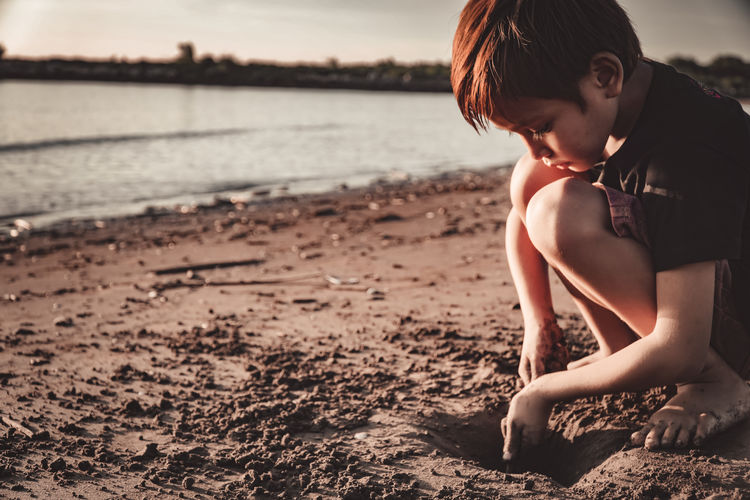 Side view of boy on beach