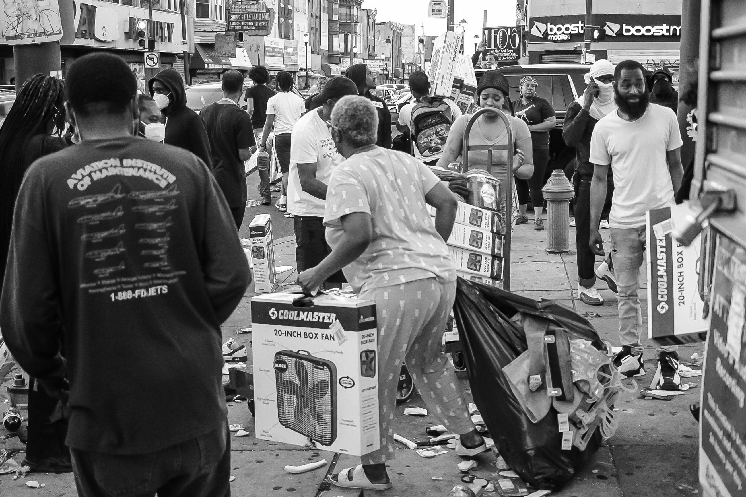 road, street, crowd, group of people, black and white, infrastructure, architecture, city, monochrome, monochrome photography, men, large group of people, built structure, building exterior, rear view, women, adult, text, black, day, city life, lifestyles, person, clothing