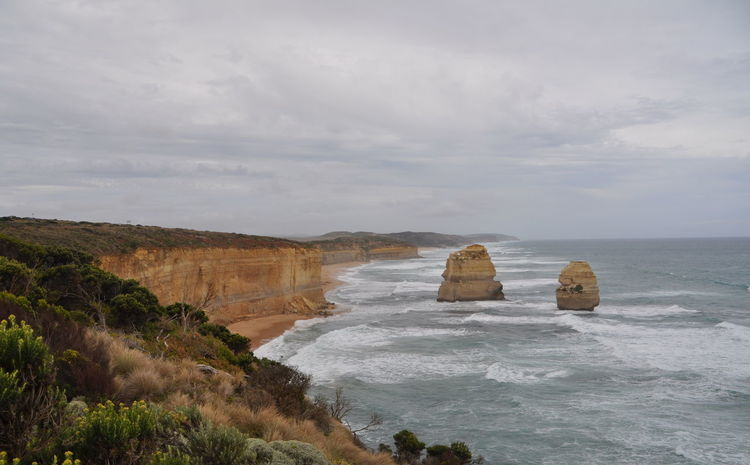 12 Apostles Australia Beach Beauty In Nature Cloud The Great Outdoors - 2016 EyeEm Awards Cloudy Coastline Horizon Over Water Idyllic Landscape Landscapes With WhiteWall Nature Rock Rock - Object Rock Formation Scenics Sea Seascape Shore Sky Tranquil Scene Tranquility Water The KIOMI Collection