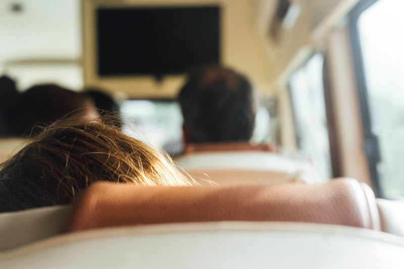 Cropped image of woman traveling in bus