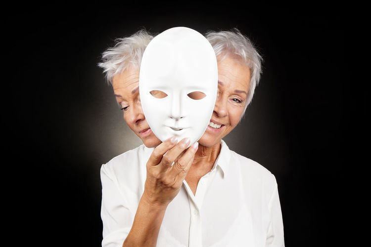 manic depression, bipolar or dramedy concept Adult Bipolar Dramedy Face Happy Happy Sad Mask Mature People Person Personality  Portrait Psychology Sad Schizophrenia Senior Studio Shot Two-faced Woman