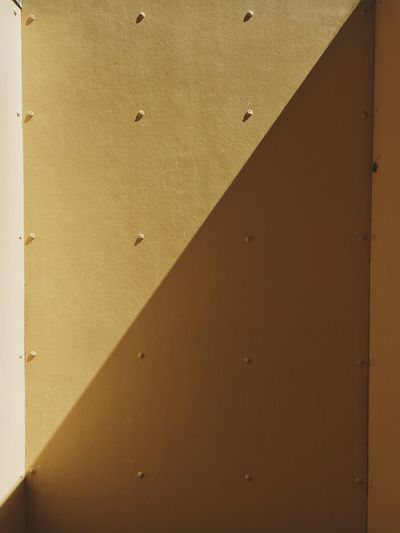 Angled light Sunlight Full Frame Built Structure Wall - Building Feature Day No People 17.62° Architecture Backgrounds Shadow Outdoors Building Exterior Textured  Yellow Pattern Wall Close-up
