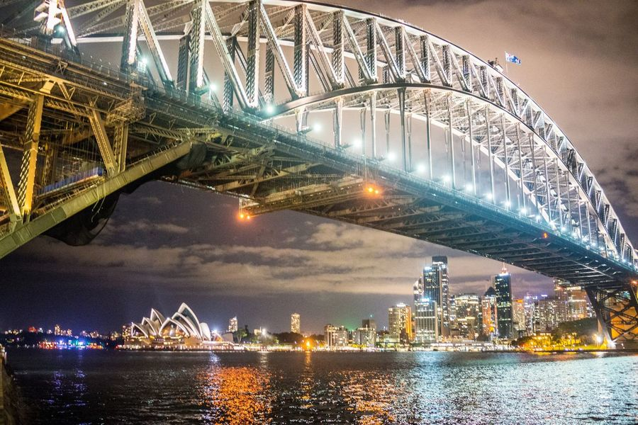 The view of Sydney Harbour at the usual night. Australia Cityscape Night Photography Sydney Harbour Bridge Sydney Opera House Sydney, Australia Arch Bridge Architecture Bridge Bridge - Man Made Structure Built Structure City Cityscape Illuminated No People Reflection Sky Skyscraper Travel Destinations Water