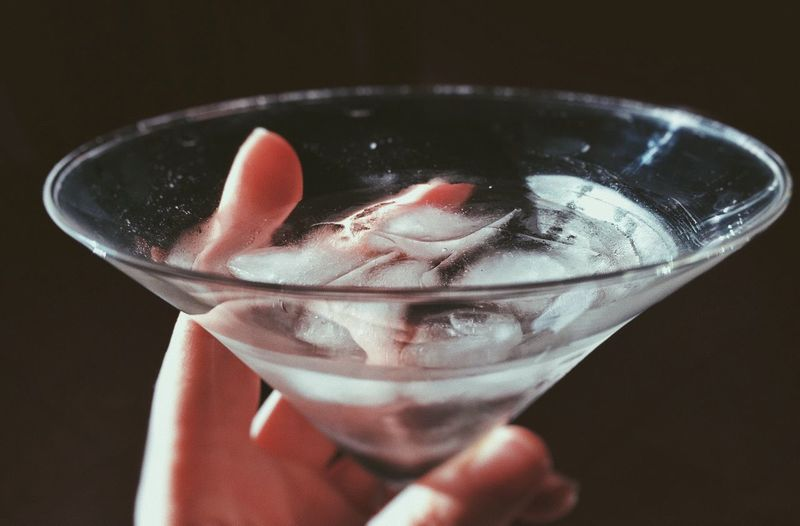 Close-up of hand holding cocktail