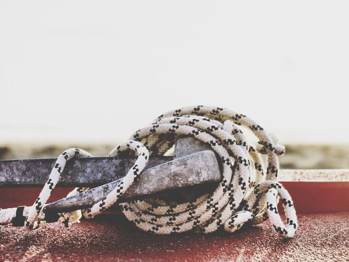 Beach No People Close-up Outdoors Day Sand Nature Beach Photography Beach Life Turned Wound Selective Focus Rescue Boat Rescue Rescue Rope Metal Still Life Safety