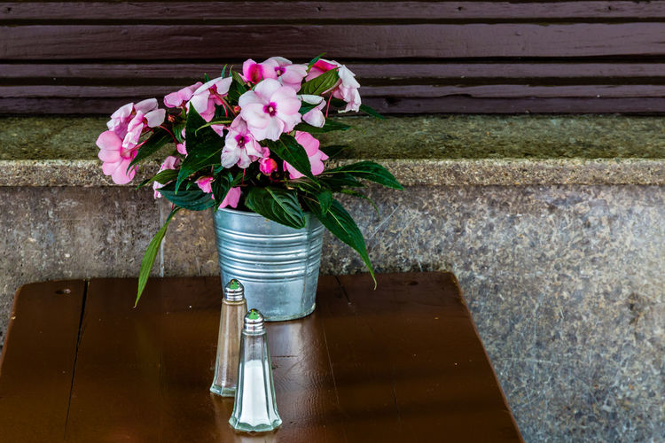 Flower pot on wooden table