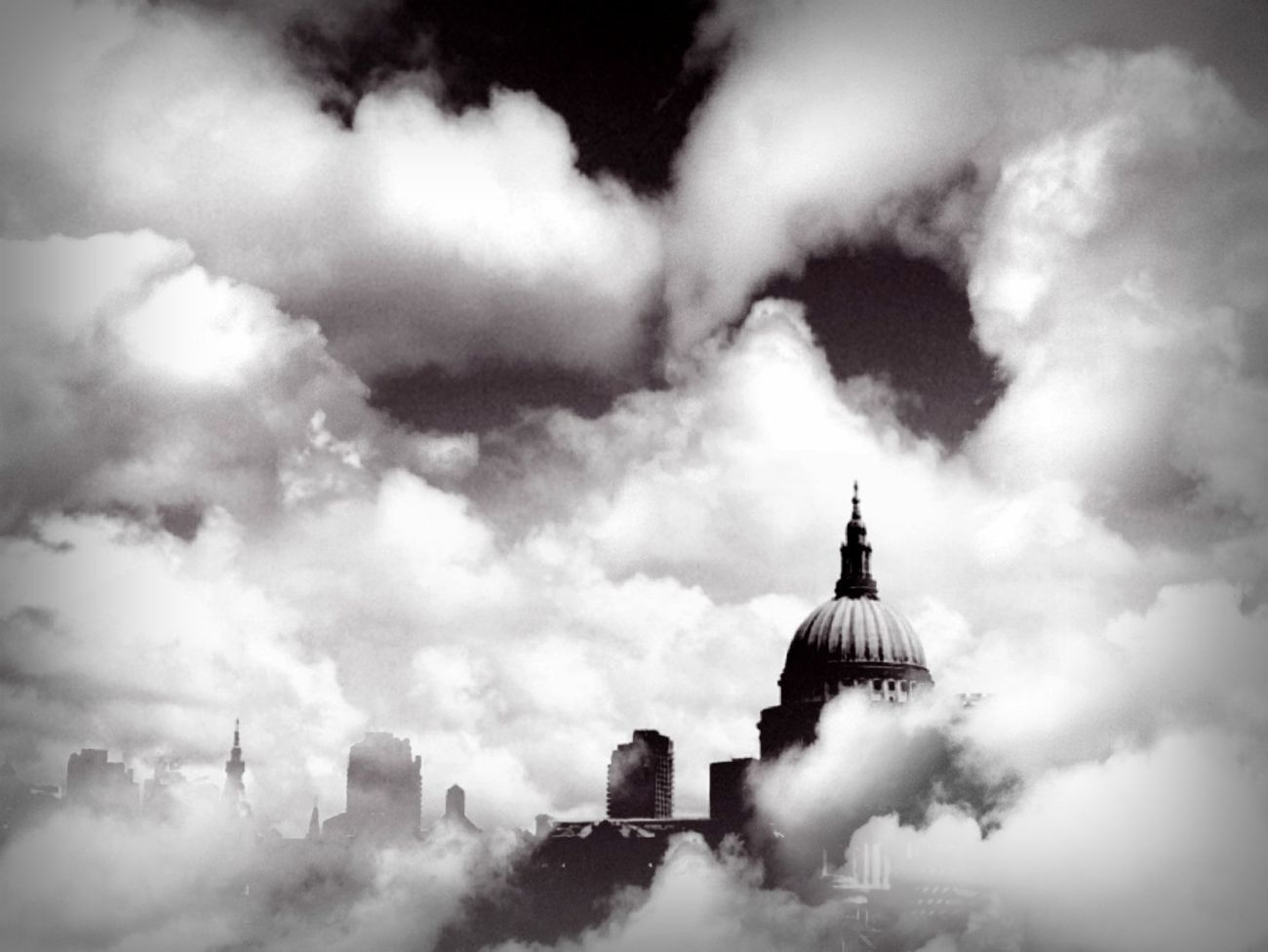 City covered with clouds