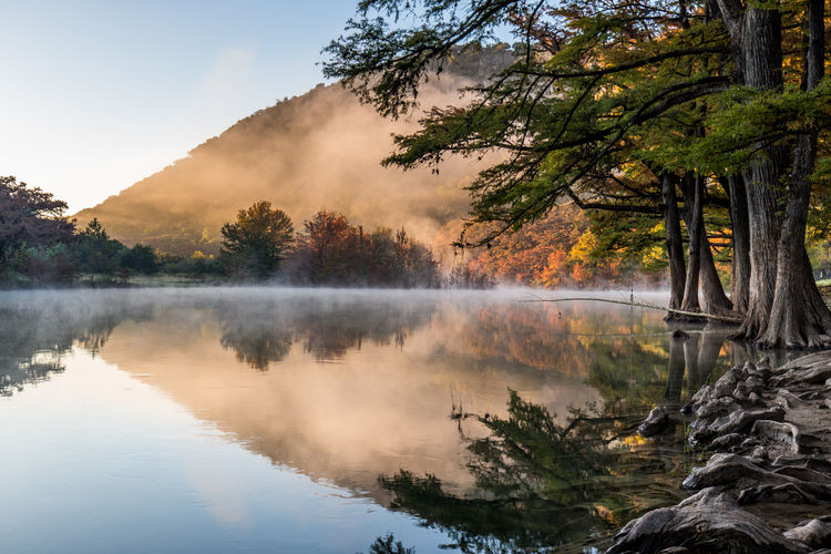 Fall is finding its way to the Texas Hill Country in this sunrise shot along the Frio River in Garner State Park Tranquil Scene Outdoors No People Fog Reflection Lake Tranquility Scenics - Nature Autumn Tree Water Reflection Lake First Eyeem Photo