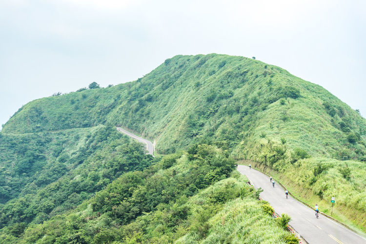 Mountain Beauty In Nature Sky Road Scenics - Nature Green Color Plant Tranquility Tranquil Scene Tree Nature Environment Transportation Day Landscape Non-urban Scene Growth Land Idyllic Remote No People Outdoors