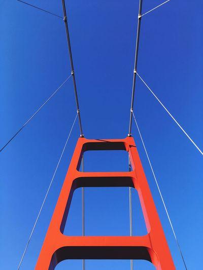 Sacramento Bay Red Color Suspension Bridge Blue Low Angle View Sky Clear Sky Built Structure Architecture No People Metal Bridge - Man Made Structure Bridge