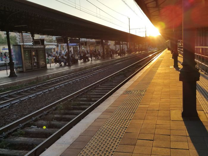 Railroad station platform during sunny day