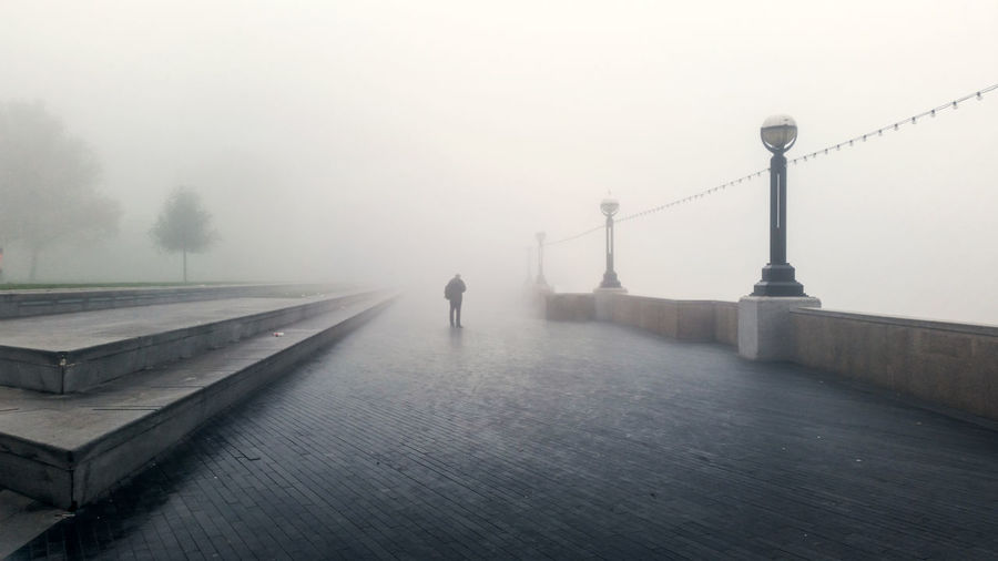 A picture taken early on a foggy morning in London at More London next to tower bridge. Abstract Adult Amazing Beautiful City Cool Day Fog Horizontal Lines London Lost More London One Man Only One Person Only Men Outdoors People Person River Sky Thames Tower Bridge