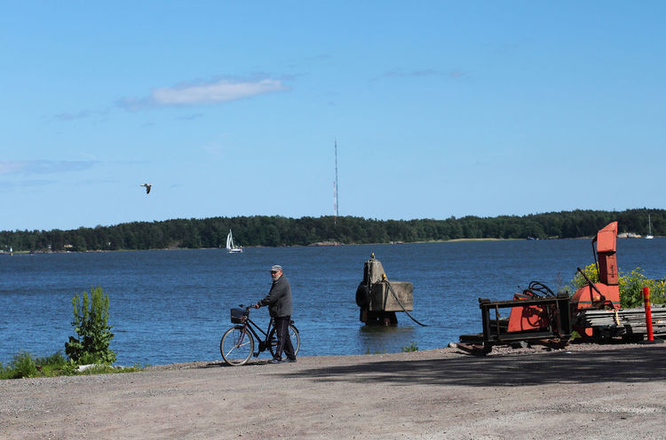 Blue Bycicle Day Leisure Activity Lifestyles Outdoors Relaxation Sky Suomenlinna Tourism Vacations Water Natural Light Portrait