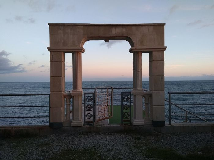 EyeEm Selects Water Sea Sunset Beach Horizon Blue Gate Summer Sky Horizon Over Water Calm Architectural Column Entrance