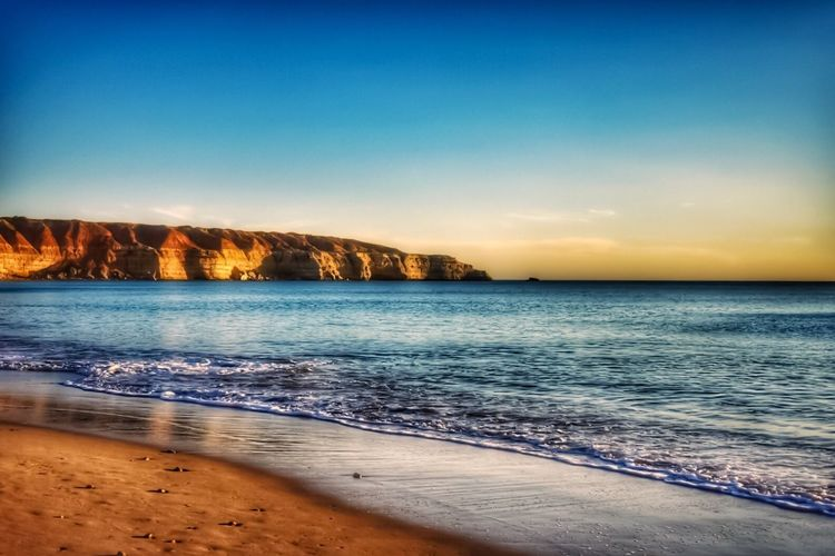 Sea Scenics Beauty In Nature Nature Beach Tranquil Scene Water Tranquility Horizon Over Water No People Sunset Sand Sky Outdoors Blue Travel Destinations Clear Sky Vacations Wave Day