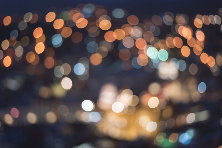 Defocused image of illuminated street lights at night
