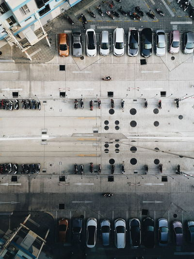 Directly Above Shot Of Cars And Motorcycles Parked On Road In City