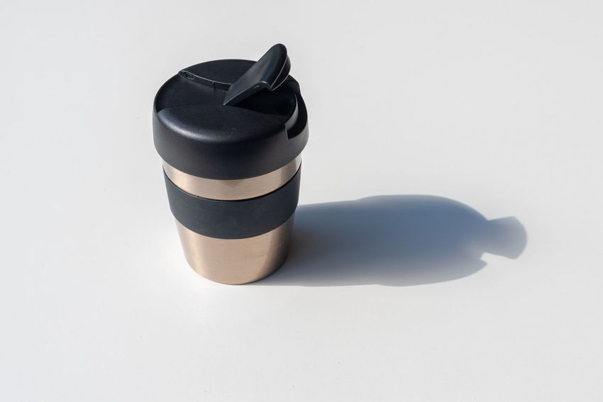 Reusable coffee cup with hard shadow Black Color Close-up Coffee Cup Container Copy Space Cut Out Gray High Angle View Indoors  Man Made Man Made Object No People Personal Accessory Shadow Silver Colored Single Object Still Life Studio Shot Table White Background White Color