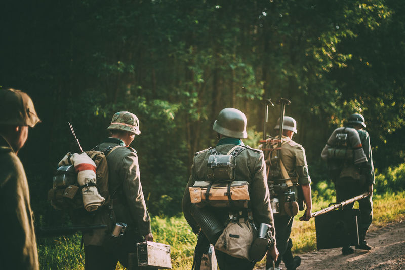 Unidentified re-enactors dressed as German soldiers during march through summer forest War Forest Gun Weapon Ww2 WWII Ww1 Army Soviet Ussr Re-enactors German History Millitary Histirical Wehrmacht Russian The Photojournalist - 2019 EyeEm Awards