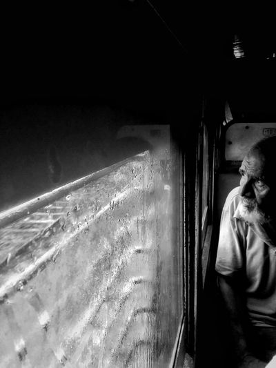 In the busy world , someone is still calm and quiet. Water Only Men One Person Night Adults Only People One Man Only Real People Adult Men Outdoors Train Window Travel Photography Travel Portrait Portraiture Portraits Old Oldman Smartphoneclick EyeEm Best Shots EyeEmBestPics EyeEmNewHere EyeEm Best Shots - Black + White