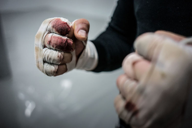 Midsection of boxer with bandages in fighting stance