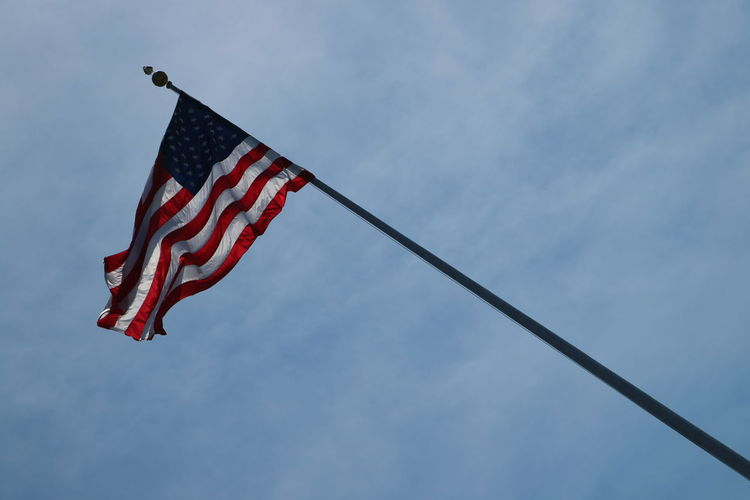 Low Angle View Patriotism Sky Flag Cloud - Sky Red Striped Nature Pole Day No People Wind Environment Blue Outdoors Waving Shape Independence National Icon
