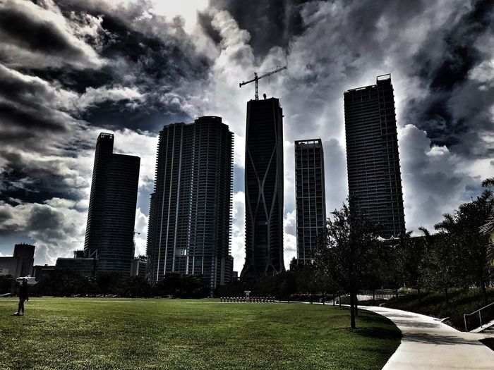 Museum Sentinels Business Finance And Industry Miami Path Forward Sidewalk Architecture Built Structure Sky Building Exterior Cloud - Sky Building Nature Grass Skyscraper Office Building Exterior Landscape City Tall - High No People Modern Day Park Outdoors Low Angle View