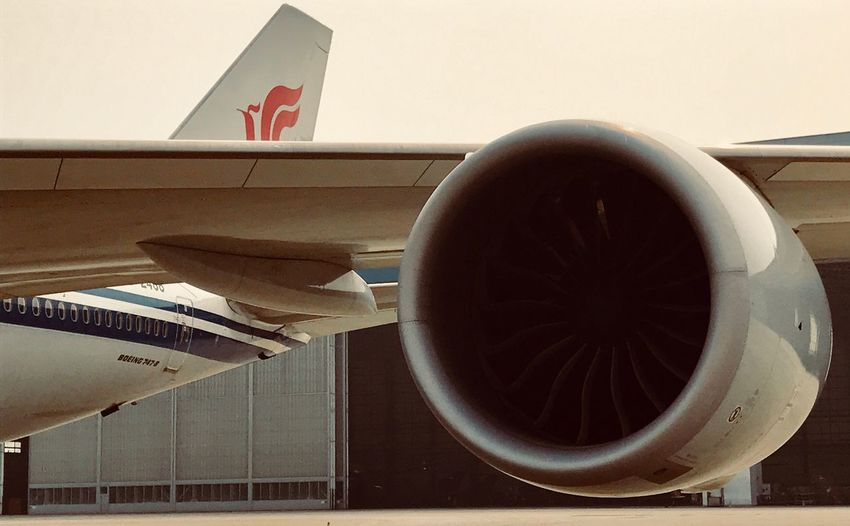 Airplane No People Transportation Day Close-up Building Exterior Air China Commercial Airplane Airport Jet Engine