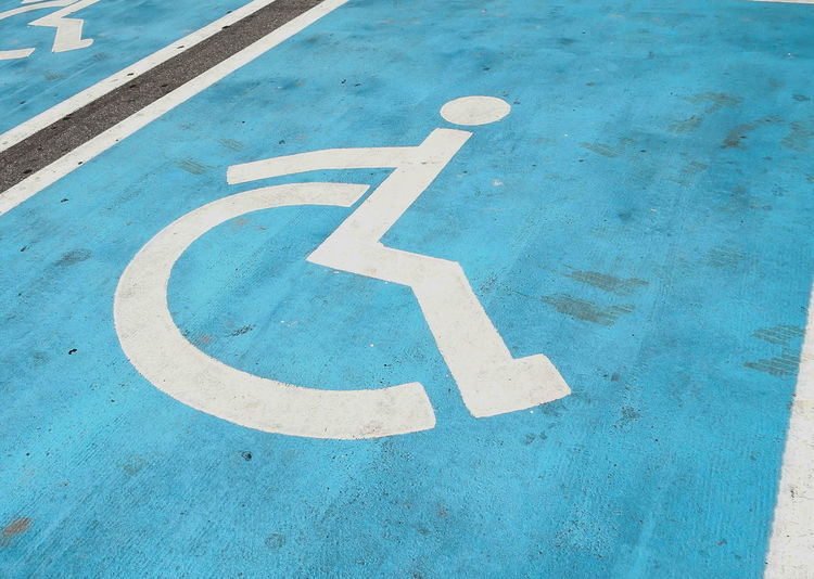 High angle view of wheelchair disabled sign on road