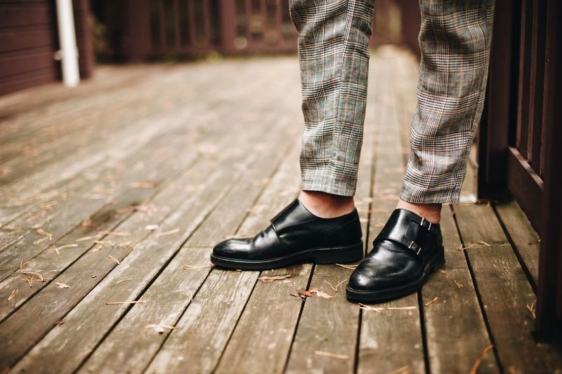 YONG MAN IN SUIT Black Color Body Part Day Flooring Focus On Foreground Human Body Part Human Foot Human Leg Human Limb Leather Lifestyles Limb Low Section Men One Person Outdoors Pants Shoe Sock Standing Wood Wood - Material