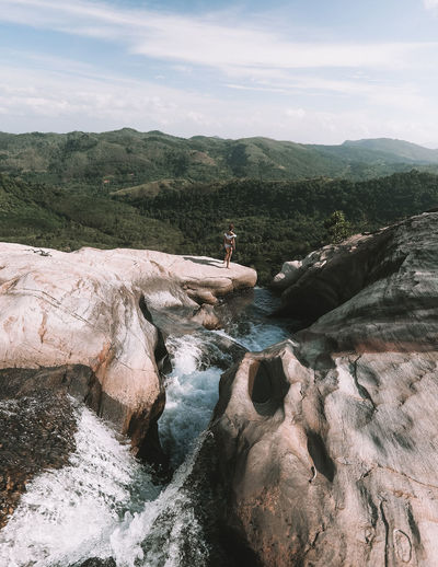 Diyaluma falls One Person Leisure Activity Nature Lifestyles Real People Beauty In Nature Day Scenics - Nature Water Rock Outdoors Sri Lanka Diyaluma Falls One Woman Only Girl Woman Standing Waterfall Bikini Lifestyle Motion View Forest Flowing Water
