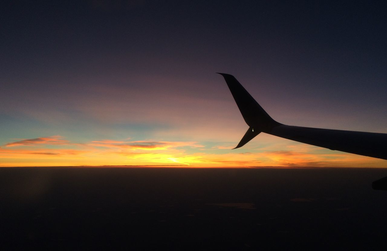 sunset, sky, airplane, air vehicle, beauty in nature, silhouette, cloud - sky, mode of transportation, orange color, transportation, scenics - nature, nature, flying, no people, aircraft wing, travel, mid-air, outdoors, sun, copy space