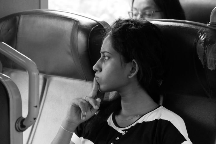 Thoughtful woman traveling in train