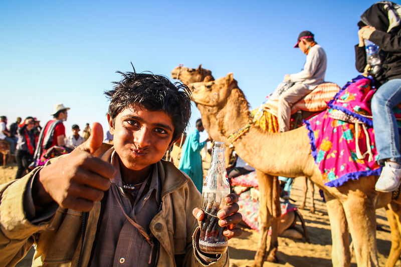 Adult Adults Only Day Desert Domestic Animals Focus On Foreground India Jaisalmer Leisure Activity Livestock Looking At Camera Mammal Men Nature One Animal One Man Only One Person Outdoors Portrait Real People Sky Thar Desert Travel Destinations Turban Young Adult