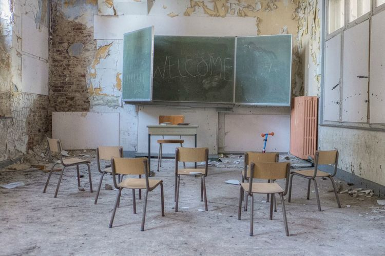 Chairs and table in abandoned classroom