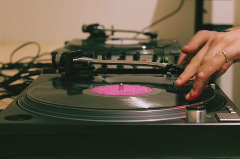 Close-Up Of Man Playing Turntable
