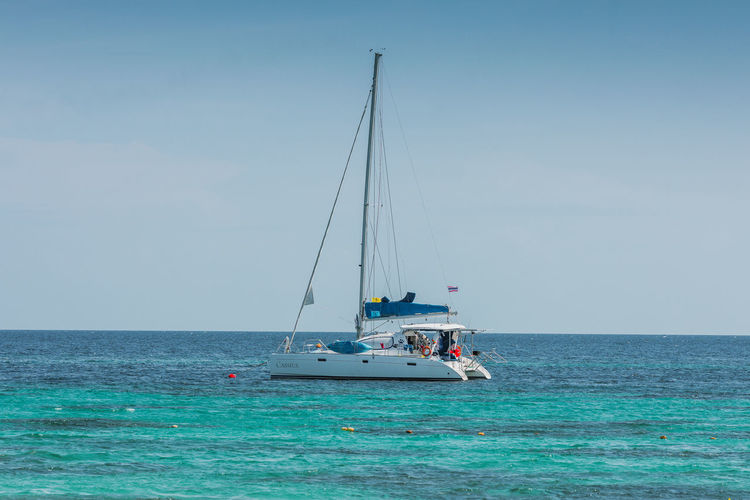 Sea Water Nautical Vessel Transportation Mode Of Transportation Sky Horizon Over Water Scenics - Nature Sailing Horizon Sailboat Day Nature Beauty In Nature Waterfront Blue Clear Sky Mast Pole Outdoors Yacht Turquoise Colored Luxury
